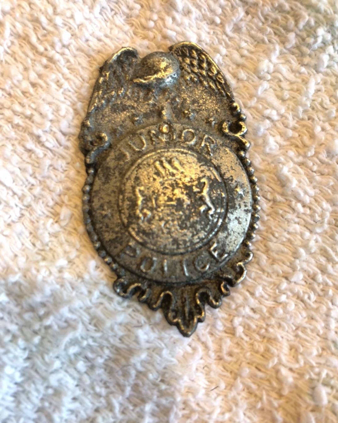 In the excavation of the parking lot Michael found a cool old toy badge. It says