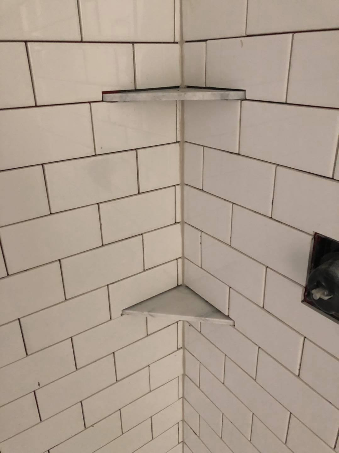 We always put a line of silicone in the corners instead of grout because grout a