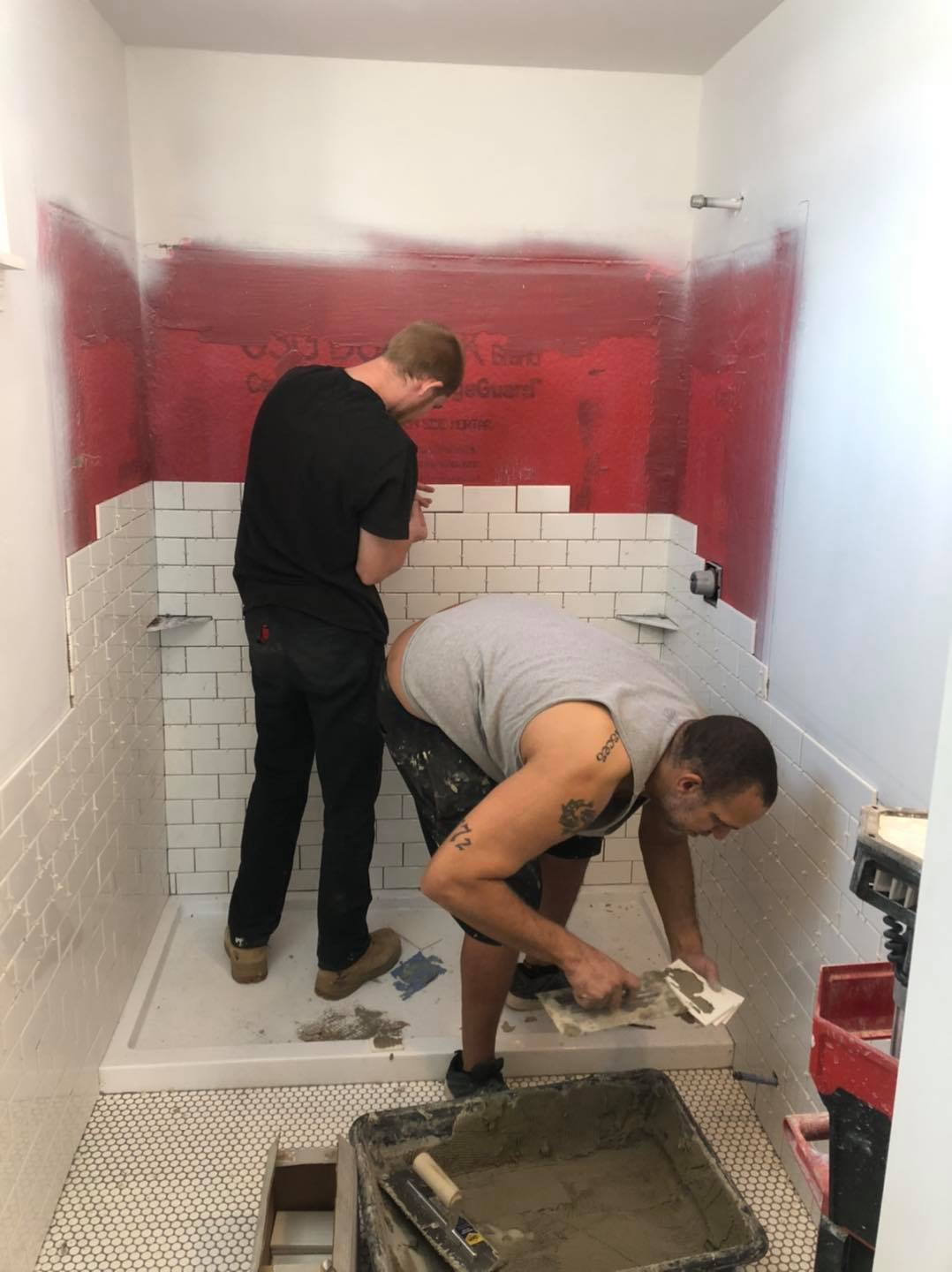 We have started tiling the bathroom walls. Norman picked out a historically appr