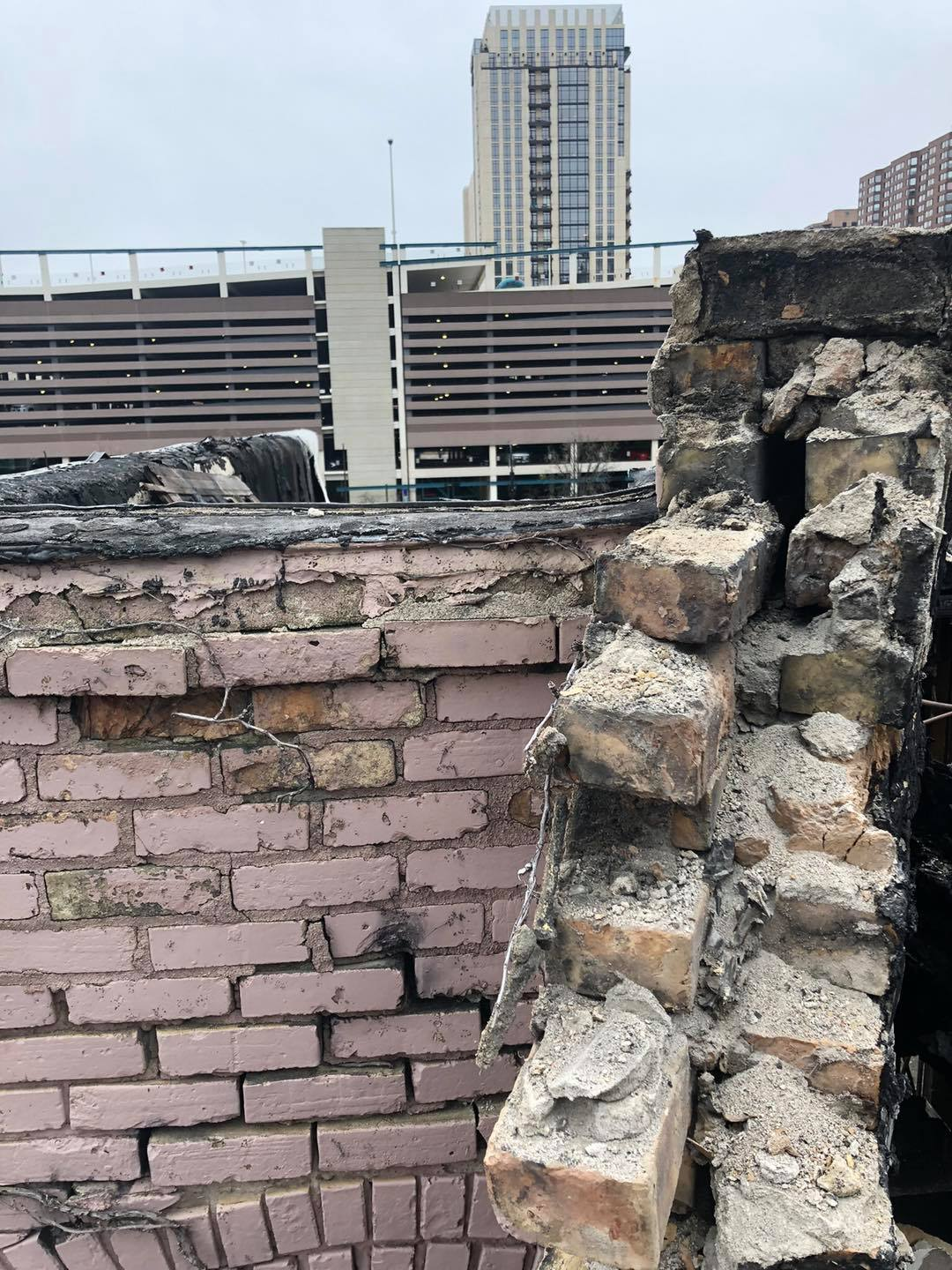 When the fire was raging, the parapets and windows were blown out by the fire ho